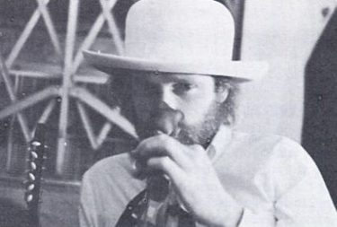 Mike Love Sniffs at a Rose