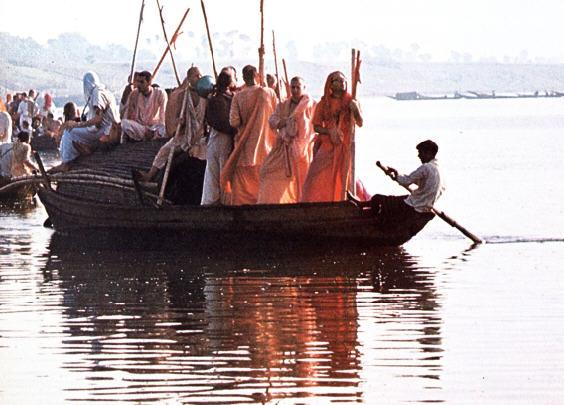 Devotees Cross The Ganga River