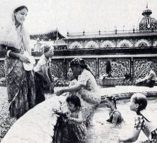 Hare Krsna Devotees Cool Off in Fountain in The Garden at Palace Of Gold