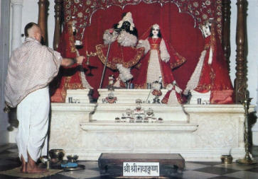 Worshipping The Deities of Radha and Krsna