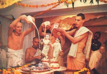 Performing Abhishek Of Lord Radha and Krishna