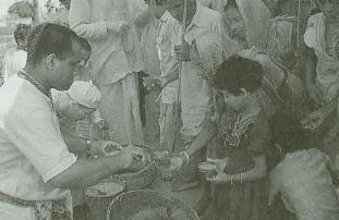 Pilgrims Receive Cups of Kicchari Prasadam