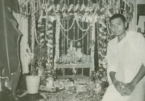 Bhakta Amit with Krsna Balaram Deities in Srila Prabhupada Room