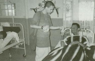 Devotee Delivers Krsna Prasadam To patient