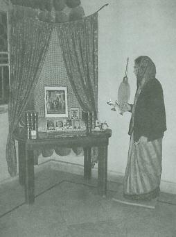 Devotee Offers Aarti to Krsna