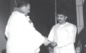 Radharaja Murari Dasa Receives Gift from Jayapataka Swami Maharaja