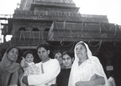 Champaklata Devi Dasi, Shyamsunder Dasa Holding a Baby