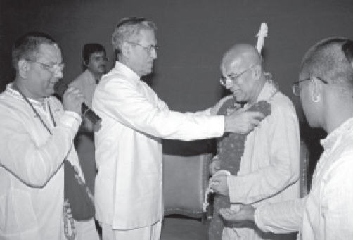 Shri B.L.Joshi The Governor of Delhi Presenting A Garland To HH Gopal Krsna Goswami