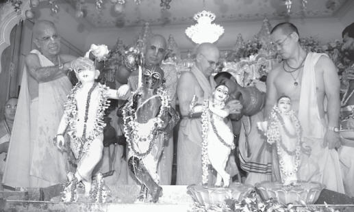 Gopal Krsna Goswami and Bhanu Swami Doing Abhiseka of The Deities