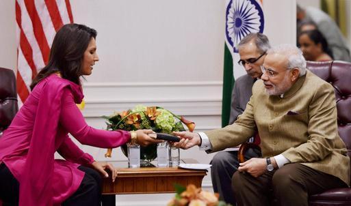 US Lawmaker Gifts Gita to Modi